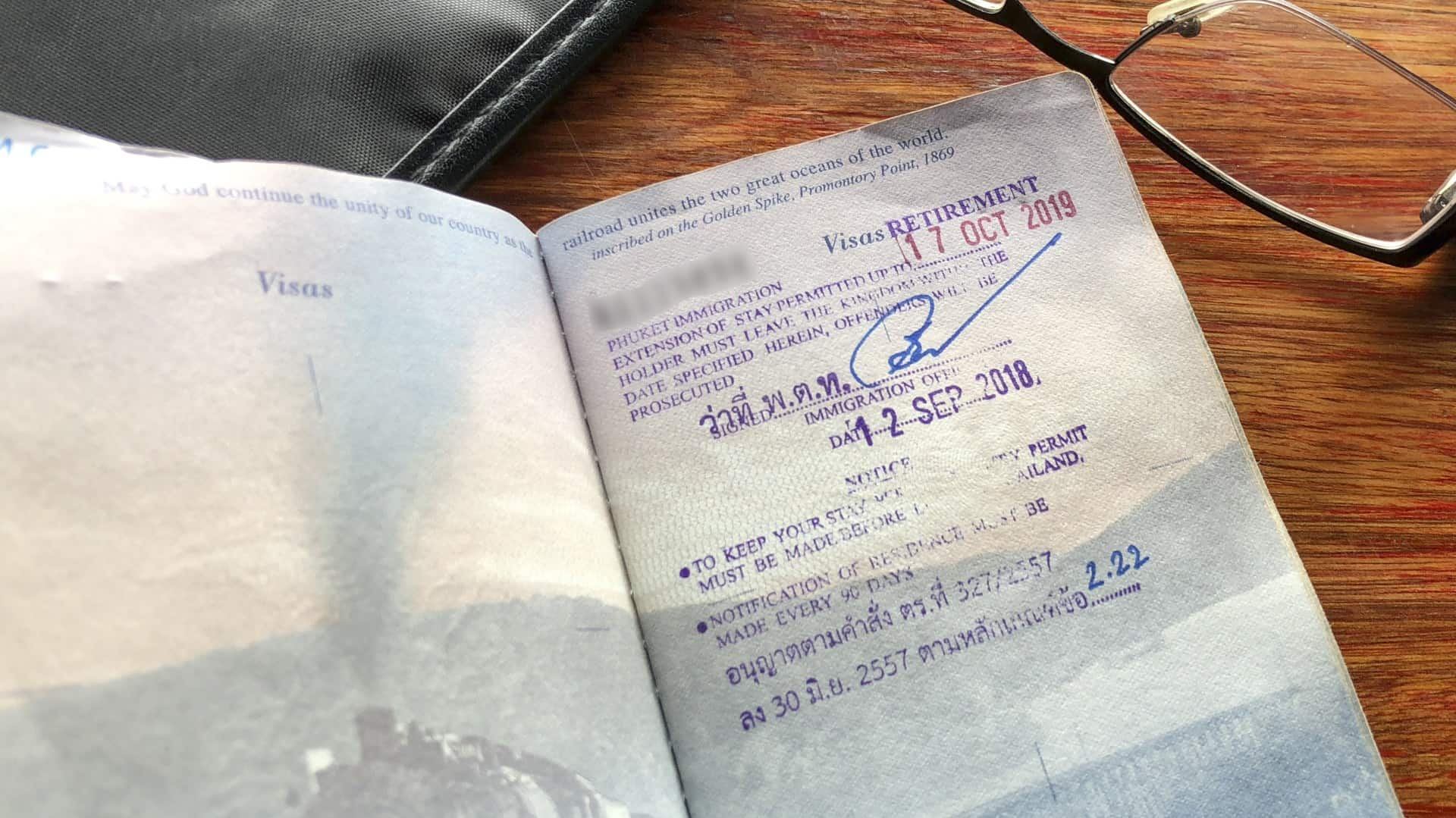 A copy of a passport page with a Thai retirement visa stamp