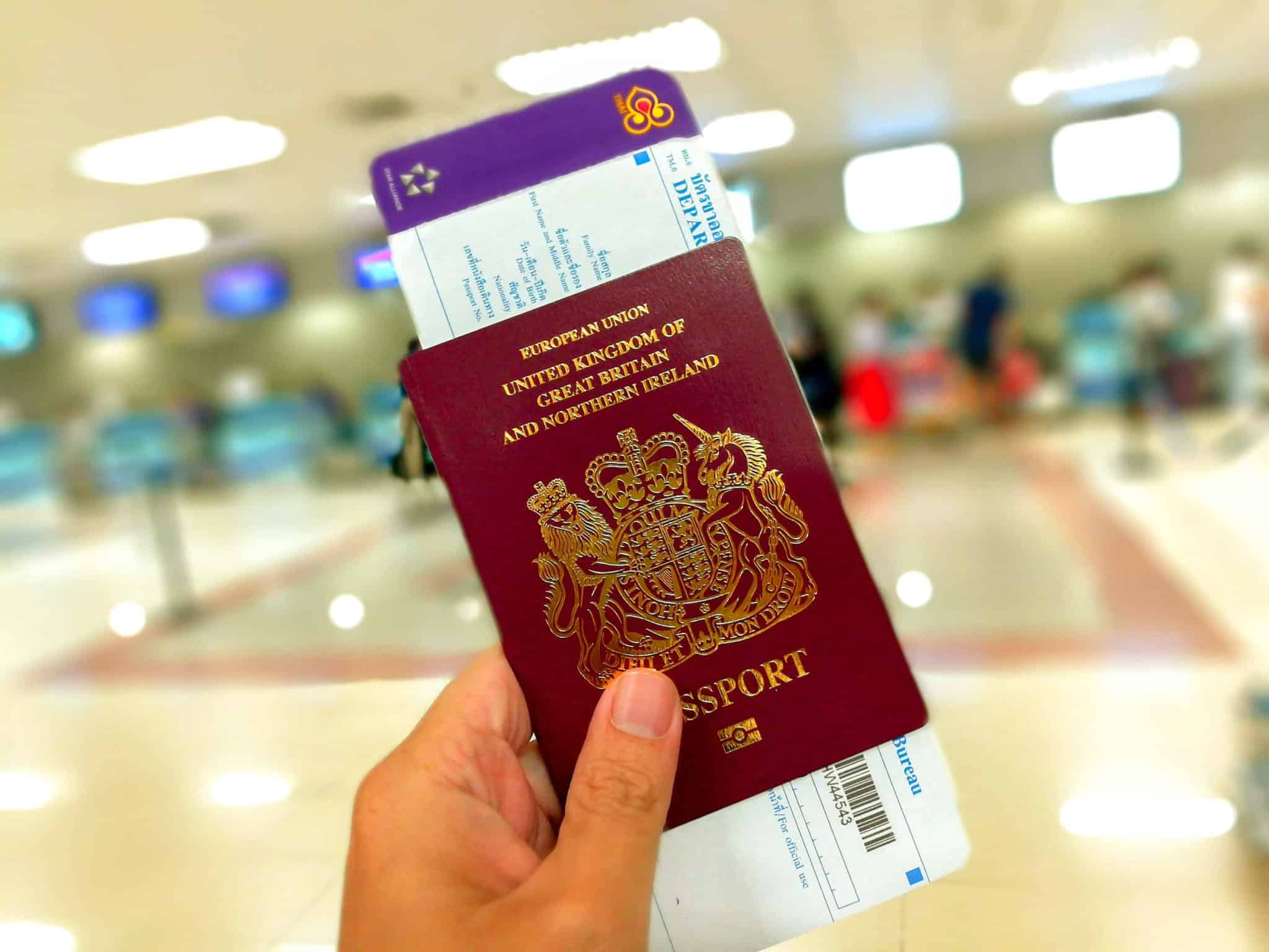 A copy of a british passport with a Thai boarding pass