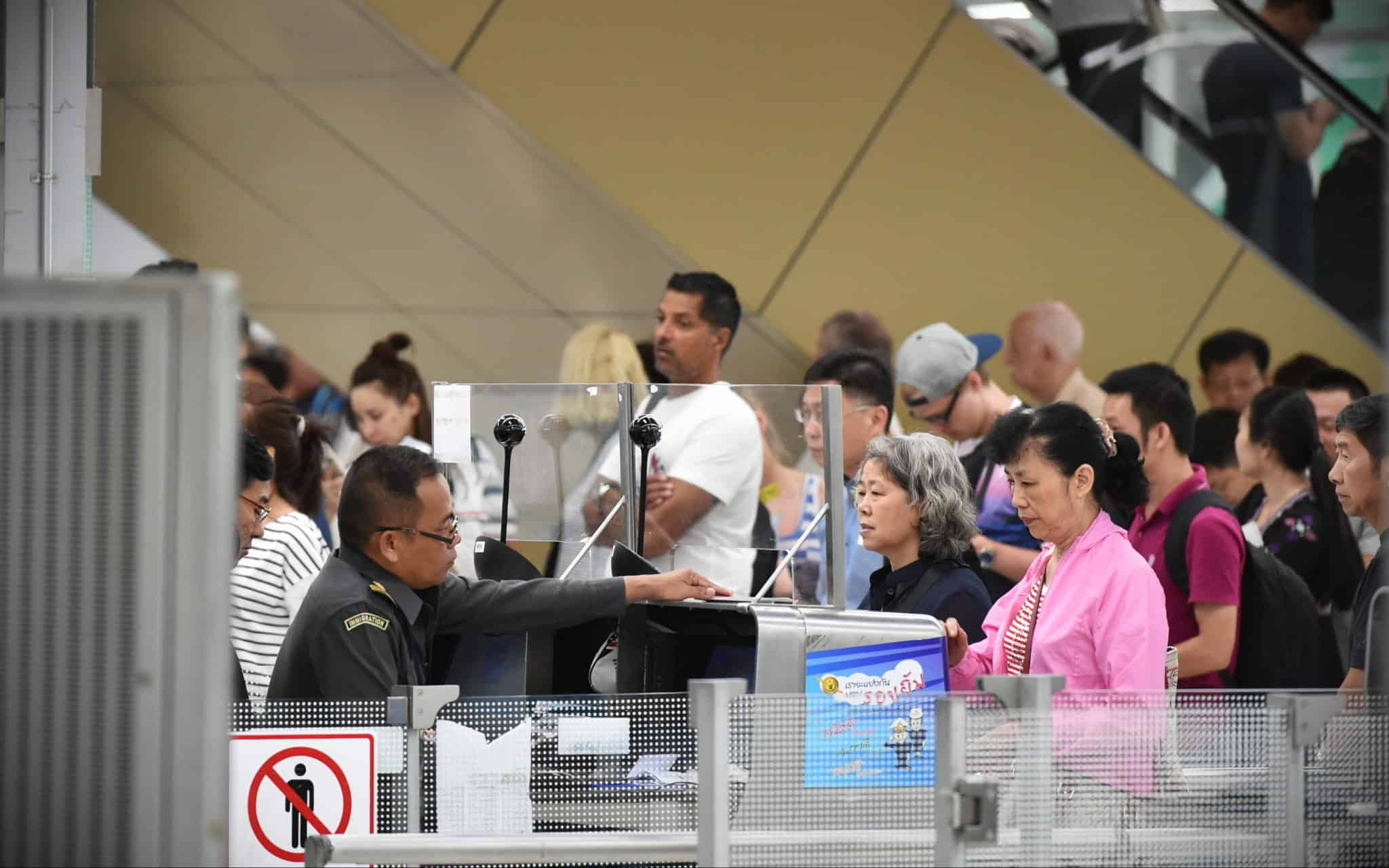People queing at Thai immigration counter